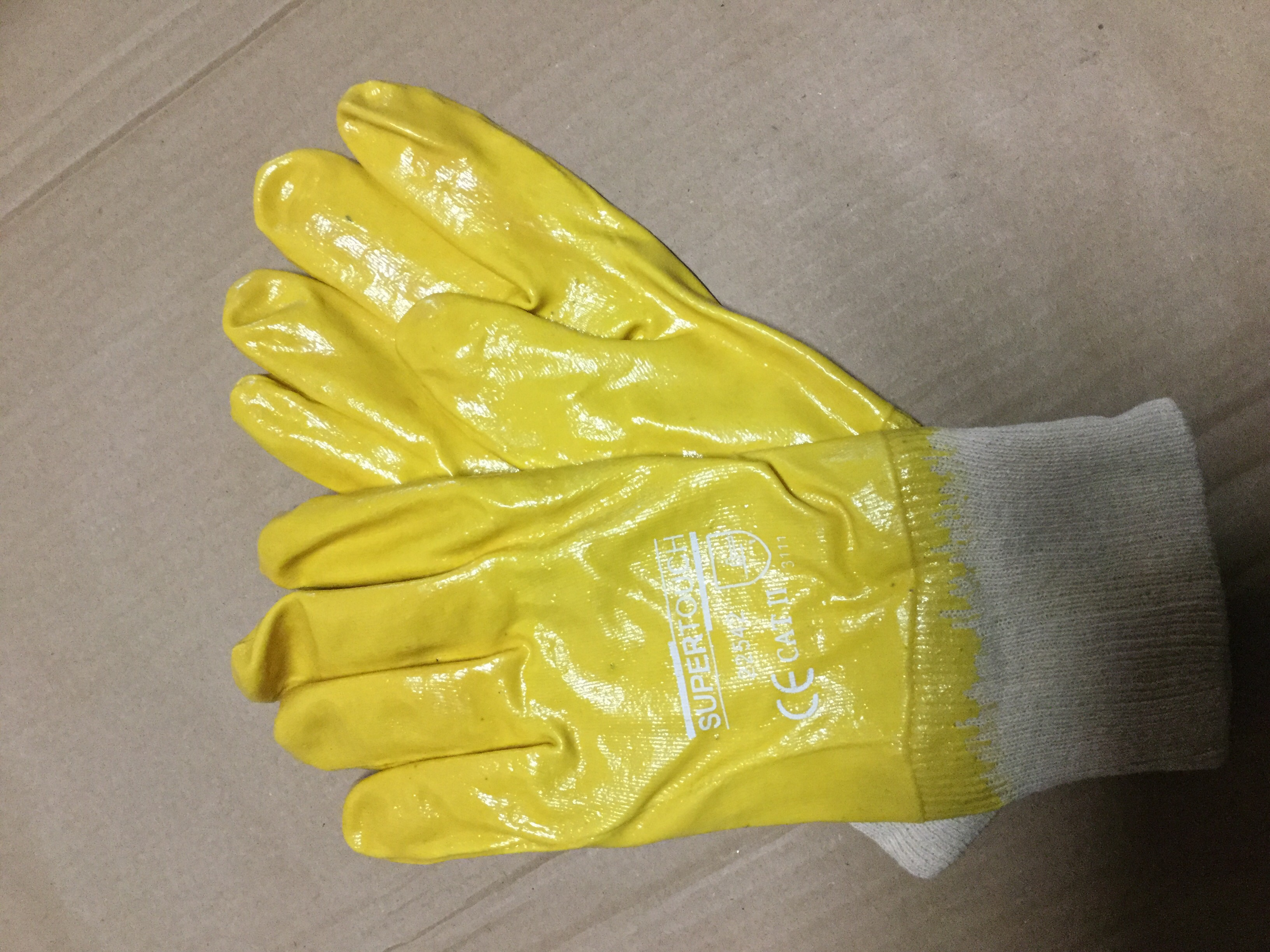 Nitrile lightweight full dip nit wrist gloves